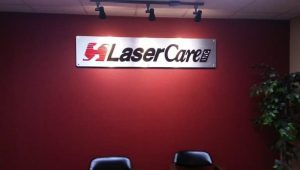 Lobby sign made out of brushed Aluminum for LaserCare