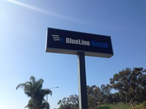 a small pylon sign for Blueline Rentals