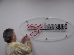 doing the finishing touches on this lobby sign