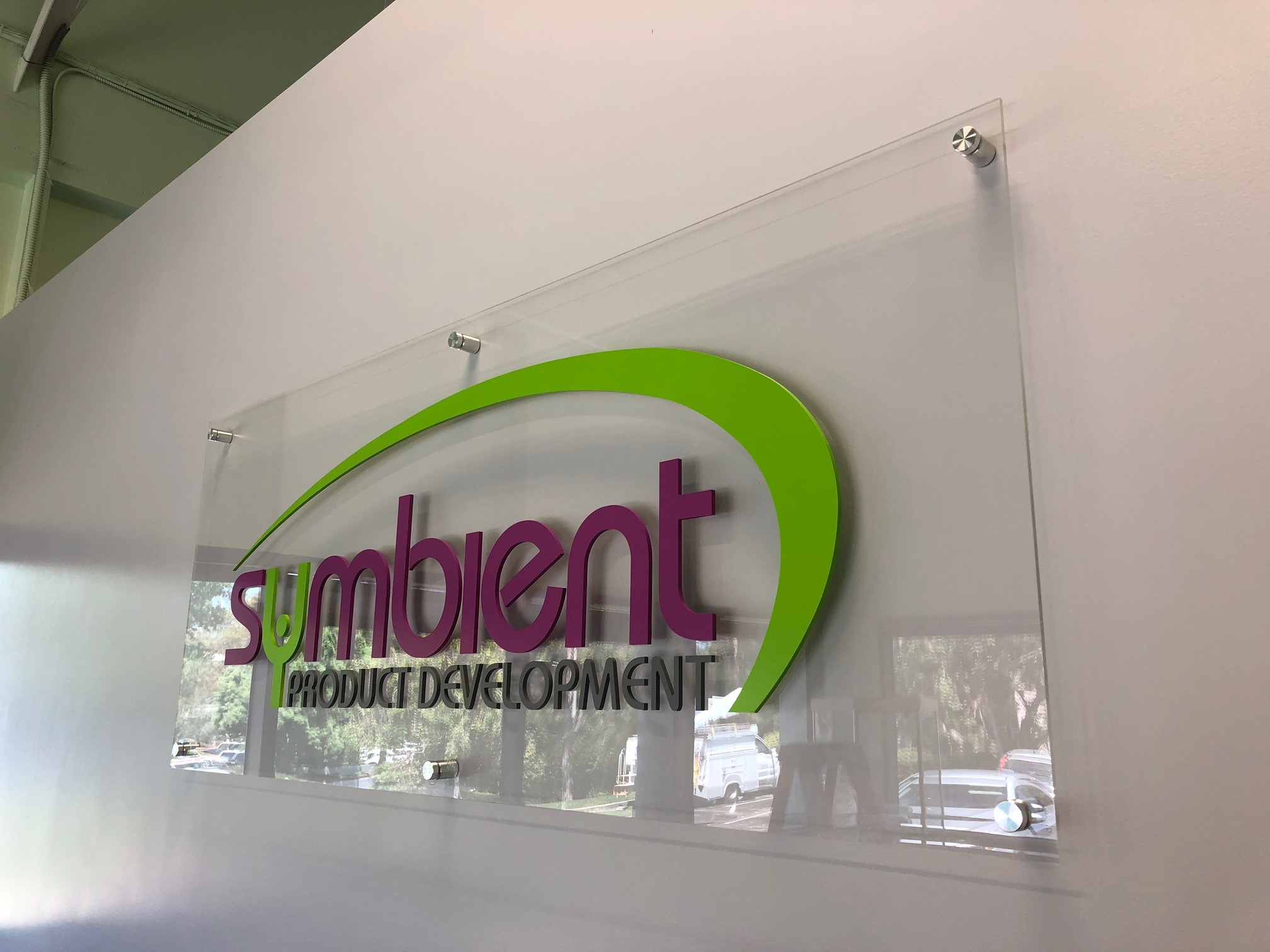 lobby sign with a clear acrylic backer and flat cut out letters