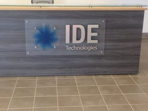 A Lobby Sign on a reception desk