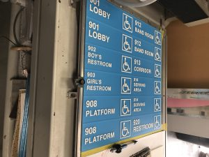 ada signs on a special machine being made