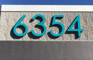 blue fabracated numbers for an address