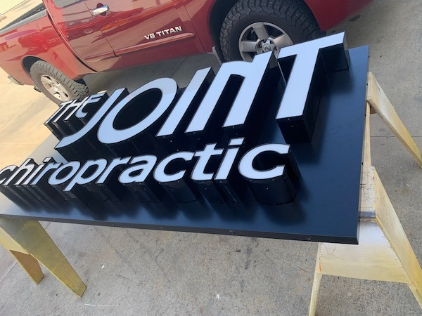 channel letters on a back panel or pan ready for crating
